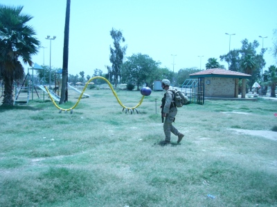 Armed men patroling to kill in a child's playground. I couldn't pass up the irony.