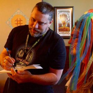 Sean signing books at the UFO Festival 2017